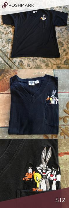 Acme clothing company V-neck pocket black T-shirt Excellent used condition V-neck T-shirt with pocket and logo with Bugs Bunny and Tweetie bird, daffy duck and Sylvester. Size extra large. No holes stains or odors. Acme Clothing co. Shirts Tees - Short Sleeve
