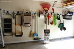 Duo Ventures: The Garage: Wall Track System - I WANT!  I'm completely impressed with this system. Still room for the car!!