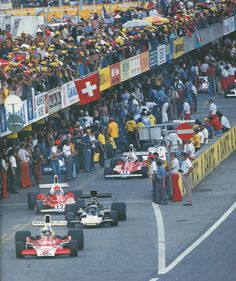 F1 CIRCUS Crowd scene at the 1975 Austrian GP.Mass,Peterson,Lauda,Regazzoni and Hunt make their escape. Osterreichring 1975 ( Schlegelmilch / Parker)