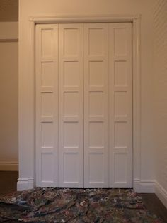 Change up old bifold closet   doors with a little wood and paint. It creates a whole new look!