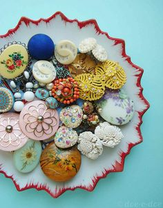 beautiful vintage buttons on sweet red rimmed plate