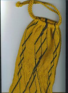 Språng pouch made in S- and Z-twist patterning with Coptic twining. Oddny says: The drawstrings are several long pieces of yarn plied into a cabled cord. (1 of 2)