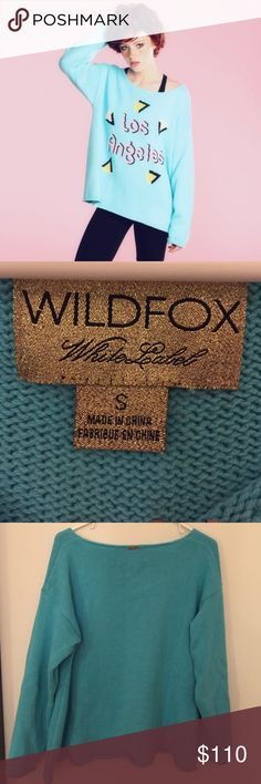 Wildfox 80's Los Angeles Molly Sweater 🌴 Wildfox 80's inspired Los Angeles oversized sweater in a size small. It has a larger neckline which really gives it that 80's vibe! Only worn once and in excellent condition! It is your chance to get this cute sweater at a discounted price cause it is sold out online 😍🌴💕 Wildfox Sweaters Crew & Scoop Necks