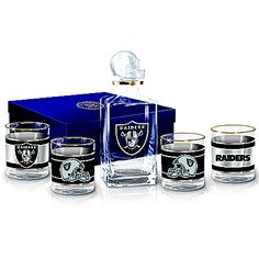 Officially licensed barware set sports your team's logo on a decanter with helmet stopper and 4 gold-rimmed glasses. Satin-lined gift box. Gold Rimmed Glasses, Gifts For Football Fans, Glass Showcase, Nfl Oakland Raiders, Atlanta Falcons, Decanter, Football Helmets, Bradford Exchange, Barware