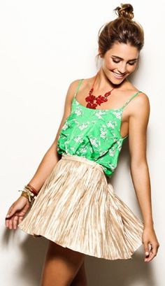 Red jewelry + green tank + gold flowy skirt.
