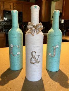 Yarn wrapped bottles wrapped wine bottles burlap by HomeEcQueen (Bottle Wrapping) Wine Bottle Art, Painted Wine Bottles, Diy Bottle, Wine Bottle Crafts, Jar Crafts, Wine Bottle Wedding, Decorated Bottles, Yarn Bottles, Yarn Wrapped Bottles