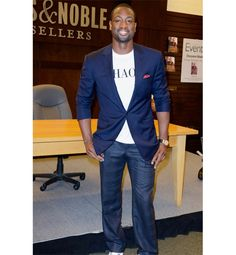 Dwyane Wade makes casual look so good. Love the blue blazer and pocket square with jeans.