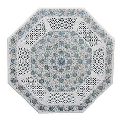 Surrealz genuine marble pietra dura table with hand carved filigree detail. Inlaid with semi precious stones - lapis lazuli, turquoise, mother of pearl