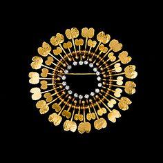 TAPIO WIRKKALA, BROSCH Diamantsol. 18K guld, diamanter totalt 0,78 ct. N. Westerback, 1972.
