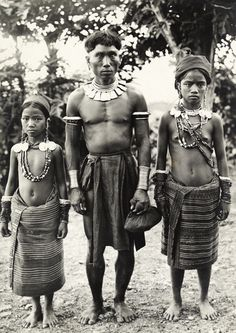 Philippines    A Kalinga man and his daughters who wear mother of pearl earrings. Luzon Island. 1910s.   ©Charles Martin.