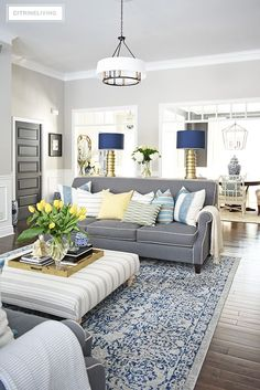 Elegant Spring decorating using pretty blue and vibrant yellow accents along with real and faux florals to help bring a sophisticated yet relaxed feel to your home. #springdecorating #springdecor #livingroom #blueandwhite