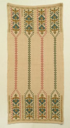 Ritual towel of heavy linen embroidered on both end with four arches enclosing flowers; arches surrounded by borders of lace in pull and wrap technique.