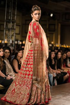 aalia bhatt in a manish malhotra designed red bridal lehenga.