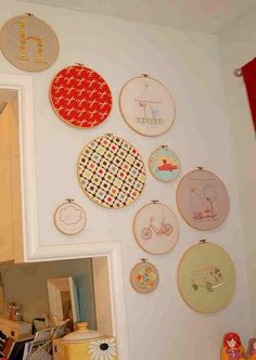 for the embroidery hoops i've been collecting from goodwill....and that center one is a great idea- i already have that orla keily fabric in the form of a single placemat that i didn't know what to do with.  win win win.