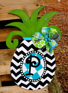 We love this whimsical pineapple door hanger. This item as well as all of our items are hand crafted and hand painted in the USA!! Message us