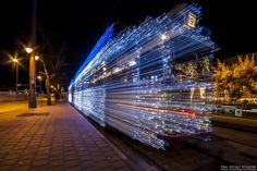 Extended exposure photography combined with a unique art installation project creates an incredible time lapse illusion on the streets of Budapest, making train cars appear to disappear in a burst of light. Click for more pictures.