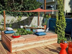 I like this bench/seating idea.  Our Favorite Designer Outdoor Rooms : Outdoors : Home & Garden Television