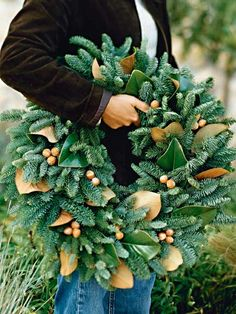 Love the magnolia leaves worked into an evergreen wreath along with some acorns - gorgeous!