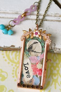 The bird keeper collage locket necklace by tiedupmemories on Etsy.