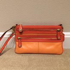 Coach wristlet Bright orange wristlet. Contrasting oranges with gold accents. Coach Bags Clutches & Wristlets