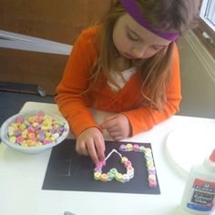 Valentines projects at school - Elmer's glue, black construction paper, and conversation hearts