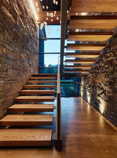 Stairway to heaven. Great use of texture in the walls and atmospheric lighting. Wooden stairs to match the wooden floor