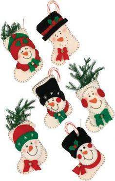 Snowmen Stocking Mini Gift Holders = Pattern no longer available but cute idea. Handmade Christmas Decorations, Felt Christmas Ornaments, Christmas Tea, Christmas Sewing, Christmas Snowman, All Things Christmas, Holiday Crafts, Christmas Stockings, Christmas Holidays