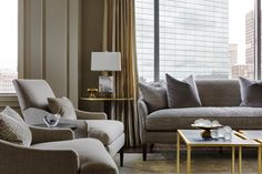 living room, heather vaughan design, seating, upholstery, wood floor, window treatments, floor lamp, city view, coffee table, table lamp, side table, gold, white, black
