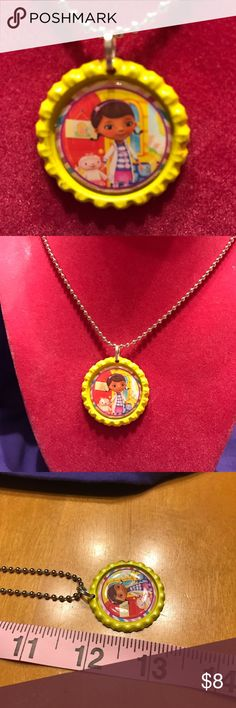 Doc McStuffins Bottle Cap Necklace Doc McStuffins Bottle Cap  Handmade! New!  Please not there may be a slight color difference due to lighting Accessories Jewelry