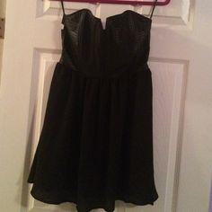 Black dress F21 Black dressy the top is leather and the bottom skater like dress. Great condition and new with tags. Forever 21 Dresses Strapless
