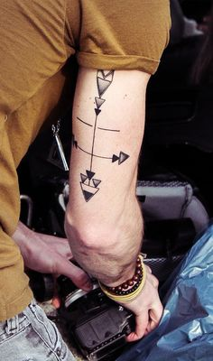 Geometric Arrow Tattoo