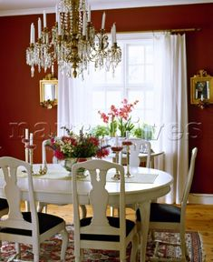 Traditional  red dining room  white painted table  chairs  glass chandelier   interiors  rooms  bold