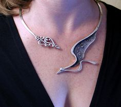 Darkwing Bird in Flight torque necklace in sterling silver available on Etsy:  https://www.etsy.com/listing/165301459/darkwing-sterling-silver-bird-in-flight?ref=shop_home_active_7