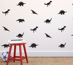 We love the idea of decals to create an accent wall in the nursery. How fun are these dinosaur decals from @danadecals?! #PNpartner