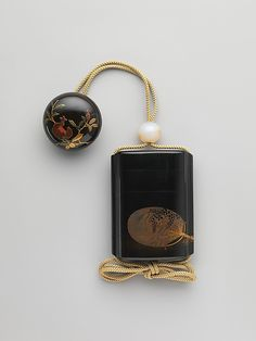 Case (Inrō) with Design of Fireworks (obverse); Design of Fan (reverse), Edo period (1615–1868), 19th century, (Case): red lacquer and powdered gold and silver (maki-e) on black lacquer; Fastener, (netsuke): colored lacquer on black lacquer with design of pomegranate, H.7.2; W.5.4; D. 2.3 cm ©The Metropolitan Museum of Art #Inro, #Urushi, #Laque, #Japon, #Lacquer, #Japan