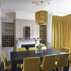 Pop of color in black and white dining room from Boconcept yellow Felt Cantono Chairs (available in more options). Nice contrast against the Amari Dining table!