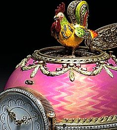 The Rothschild Clock Egg, Egg of Imperial Quality, varicoloured gold, pearls, diamonds, enamel, 1902. Presented by Beatrice Eprussi de Rothschild to Germaine Halphen on the occasion of her engagement to Beatrice's brother Baron Edouard de Rothschild. Russia, Moscow by Alexander Ivanov