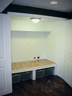 raised washer and dryer laundry closet LOVE the wood trim for the pedestal!!!