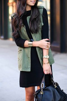 daytime event outfit Olive green vest with black dress and gold accessories Vest Outfits, Mode Outfits, Casual Outfits, Fashion Outfits, Womens Fashion, Military Vest Outfit, Military Chic, Moda Fashion, Fashion Goth