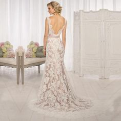 Wedding Dress, Floor-Length, made of lace, and aplliques with a beautiful court train.