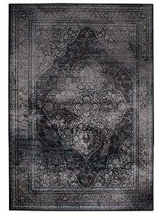 Black oriental/persian rug. Stunning