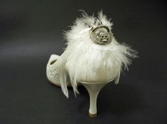 Couture Angel Wings White Feather Bridal Shoe Clips Accessories. Angel wings feather shoe clips .  Turn any pumps into hot designer shoes. These couture shoe accessories are great for going out, special occasions, spice up your bridal shoes. : ) They also make a great gift!  Handmade in white with authentic Born to Raise Hell skull and wings -a symbol of good luck and happy journeys. Set of two. Shoes are not included. Attached to shoe clips.  CUSTOM ORDERS: http://Floreti.com
