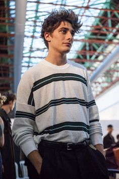 Checks & stripes were the underlying theme of AMI's SS17 show at PFW. Discover some of our favourite looks in our exclusive backstage photos.