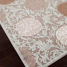 Viscose and chenille rug with a damask and medallion motif.   Product: RugConstruction Material: Viscose and chenille
