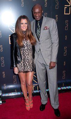 Khloe Kardashian in a leopard print dress and Lamar Odom