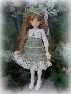 Gorgeous outfit, crocheted -- so well done.  On eBay.