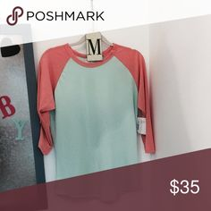 """Randy by Lularoe LuLaRoe's """"Randy"""" shirt resembles a baseball tee with its raglan, mid length sleeve in a contrasting fabric.  It's everything a tee shirt should be: stylish, easy, and comfortable. LuLaRoe Tops Tees - Long Sleeve"""