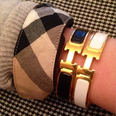 Hermes clic bracelets with a hint of Burberry on the sleeve!