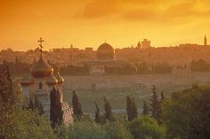 sunset view from Mount of Olives, with Church of Mary Magdalene (Russian) and Dome of the Rock