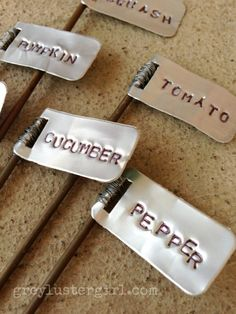 DIY garden markers using soda cans which are very easy to stamp metal letters into. DIY garden markers using soda cans which are very easy to stamp metal letters into. Aluminum Can Crafts, Aluminum Cans, Metal Crafts, Vegetable Garden Markers, Garden Plant Markers, Herb Markers, Garden Crafts, Garden Projects, Garden Art